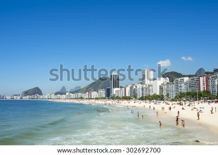 Scenic view of Copacabana Beach shore from the Leme end with skyline of Rio de Janeiro Brazil - stock photo
