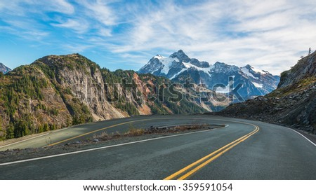 scenic view of curve and slope asphalt road on the mountain on the day in summer season.