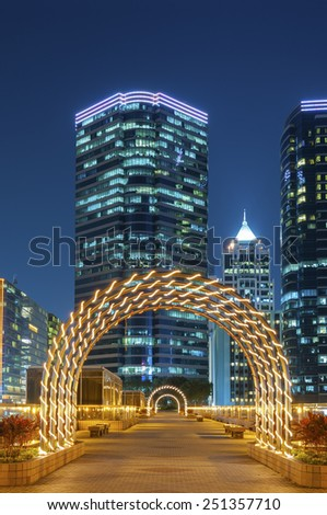 Scenic view of decorated city park at night - stock photo