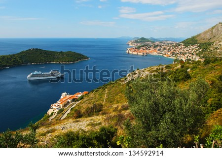 Scenic view of Dubrovnik coast with cruise ship - stock photo