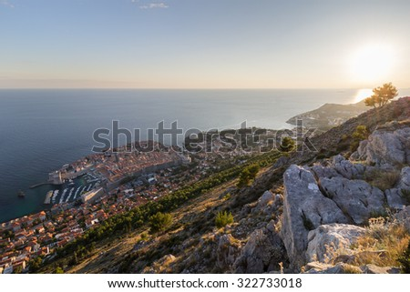 Scenic view of Dubrovnik's Old Town and beyond from the Mount Srd in Croatia. - stock photo