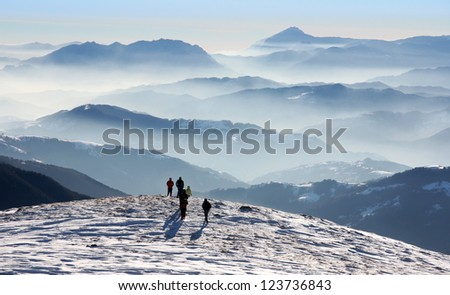 Scenic view of Fagaras Mountains in winter with peaks and foggy valleys