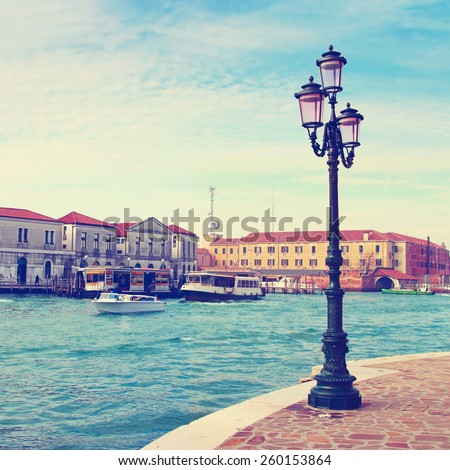 Scenic view of Grand canal from embankment in beautiful Venice, Italy. Color toning effect is applied. - stock photo