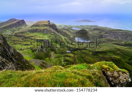 Scenic view of green Quiraing coastline in Scottish highlands, United Kingdom - stock photo