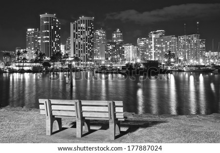 Scenic view of Honolulu city light up and Waikiki Beach at night in black and white image; Hawaii ,USA - stock photo