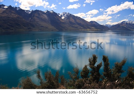 Scenic view of Lake Wakatipu with Southern Alps in background near Queenstown, South Island, New Zealand