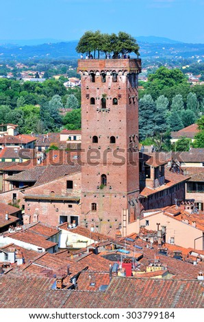 Scenic view of Lucca and Guinigi tower from Torre delle Ore, Lucca, Italy  - stock photo