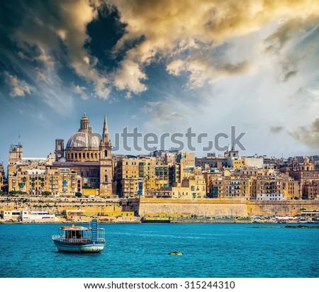 scenic View of Marsamxett Harbour and Valletta in Malta at sunset - stock photo