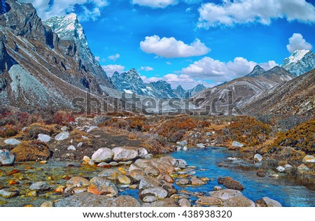 Scenic view of mountains  and valley in Sagarmatha National Park in the Nepal Himalaya near mountain Everest - stock photo