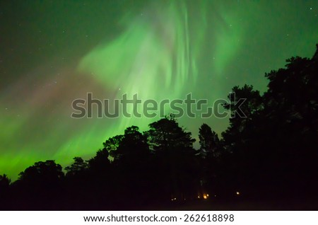 Scenic view of northern lights (Aurora borealis) - stock photo