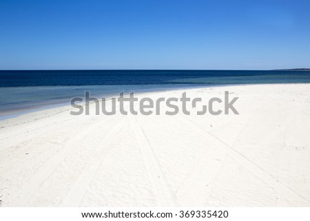 Scenic view of peaceful Indian Ocean lapping onto white sand  at Hutt's beach, near Bunbury, Western Australia on a hot summer day.