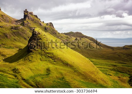 Scenic view of Quiraing mountains, a popular destination for hikers, with dramatic sky in the Isle of Skye, Scottish highlands, United Kingdom - stock photo