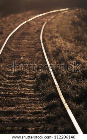 Scenic view of rails in dusk - stock photo