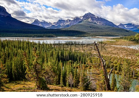 Scenic view of river and montains near Icefield parkway, Rocky Mountains, Canada - stock photo