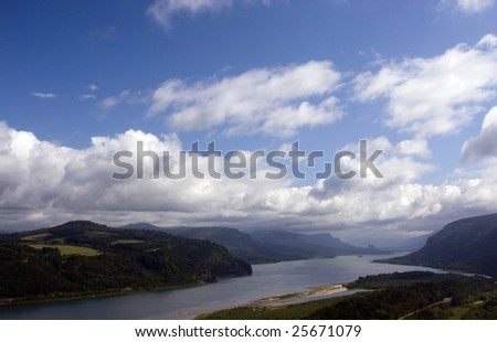 Scenic view of river and mountains - stock photo