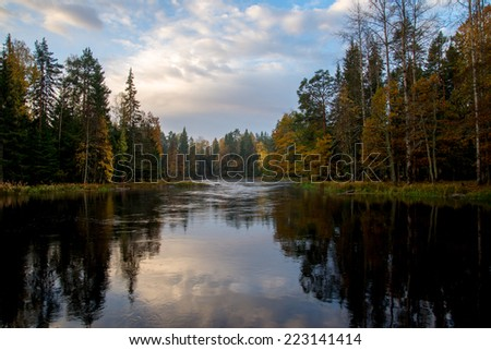 Scenic view of river in autumn before the sunrise - stock photo