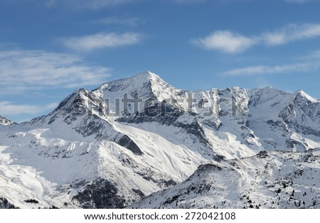 Scenic view of rocky pyramid mountain among snow - stock photo