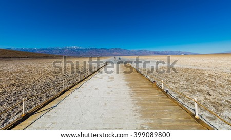 Scenic view of salt planes. The bottom of the dried-up salt sea.The bark of salt. Badwater Salt Flat, Death Valley National Park - stock photo