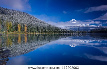 Scenic view of snow capped mountain and its reflection in lake in foreground. Mount Hood and Trillium Lake after fresh snowfall.