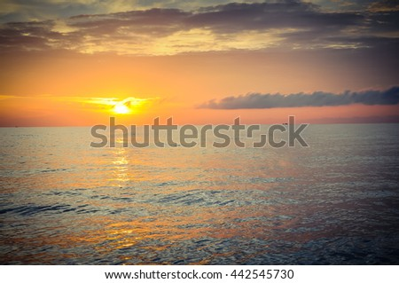 Scenic view of sunrise with colorful dramatic sky cloud above the sea in Khanh Hoa province. Early morning seascape, sunrise on the beach at the central coast of Vietnam. Nature background vintage.