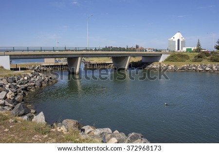 Scenic view of the  concrete  traffic bridge over the  the Leschenault Estuary  in Bunbury, Western Australia on a sunny afternoon in mid summer .