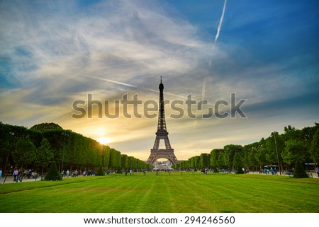 Scenic view of the Eiffel tower in Paris during sunset on a summer evening - stock photo