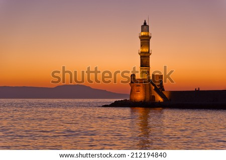 Scenic view of the entrance to Chania harbor with lighthouse at sunset, Crete, Greece - stock photo