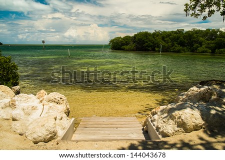 Scenic view of the Florida Keys with a small beach area and mangroves. - stock photo