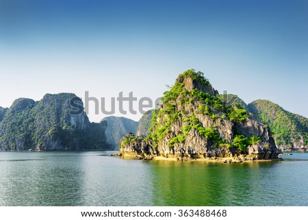 Scenic view of the Halong Bay (Descending Dragon Bay) at the Gulf of Tonkin of the South China Sea, Vietnam. Landscape formed by karst towers-isles. The Ha Long Bay is a popular tourist destination. - stock photo