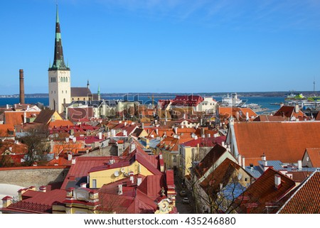 Scenic view of the old town city and sea port harbor in Tallinn, Estonia. Toompea hill with tower St. Olaf church and Russian Orthodox Alexander Nevsky Cathedral  - stock photo