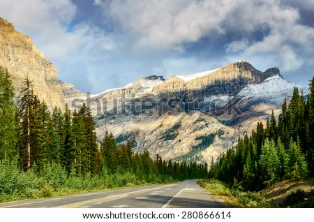 Scenic view of the road on Icefields parkway, Canadian Rockies, Canada - stock photo