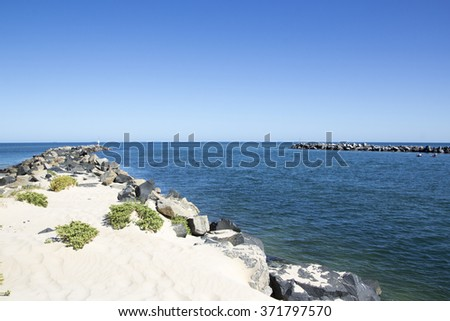 Scenic view of the rocky fishing groyne in  Leschenault Estuary  at the Cut near Australind , South Western Australia on a fine sunny morning in late summer is calm and peaceful. - stock photo