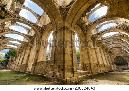 Scenic view of the ruined cloister of an abandoned monastery. HDR picture. - stock photo