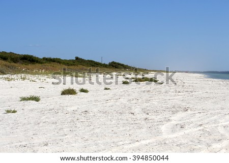 Scenic view of the soft white sandy shore at  Forrest Beach near Busselton, South Western Australia protected by Geographe Bay on a cloudy hazy afternoon in early autumn. - stock photo
