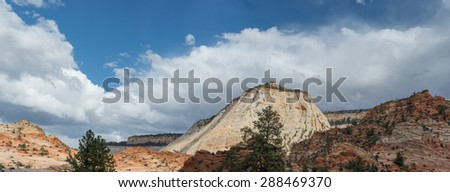Scenic view of the west side of checker board mesa in Zion National Park - stock photo