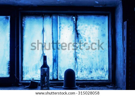Scenic view of the windows in the interior of an abandoned factory (Russia) - stock photo