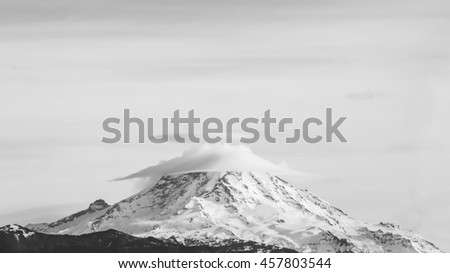 scenic view of top of mt Rainier National park with cloud cap from Seattle,Washington,usa. - stock photo