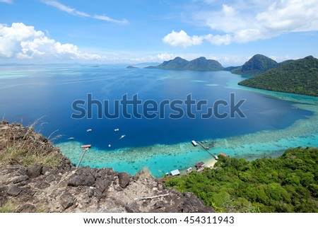 Scenic view of touristm activities and  speed boat cruise from jetty through the island from above taken from Bohey Dulang view point with clear water and coral in Sabah Borneo, Malaysia
