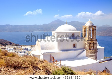 Scenic view of traditional greek cycladic church and sea, Plaka village, Milos island, Greece