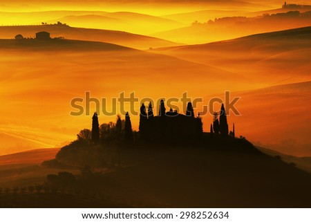 Scenic view of typical Tuscany landscape, house with hills during orange sunset, Italy - stock photo