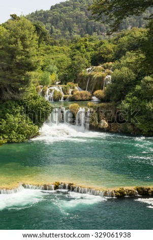 Scenic view of waterfalls, cascades and lush foliage at the Krka National Park in Croatia. - stock photo