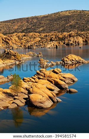 Scenic view of Watson Lake in Prescott, AZ, USA surrounded by majestic large red rock boulders and mountains. Vertical orientation. - stock photo