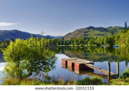 Scenic view of wooden pier on lake Ullswater, Lake District National Park, Cumbria, England. - stock photo
