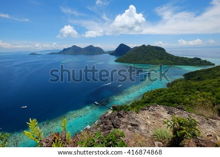 Scenic view speed boat cruise from jetty through the island from above taken from Bohey Dulang view point in Sabah Borneo, Malaysia.  - stock photo