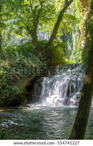 Scenic waterfall surrounded by the green forest in the Natural park of Monasterio de Piedra in Nuevalos, Zaragoza, Spain