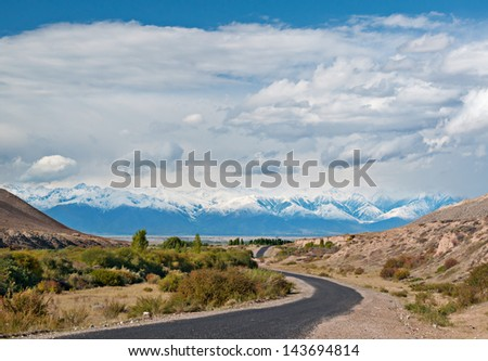 Scenic winding road to the adventure in the mountains of Tibet