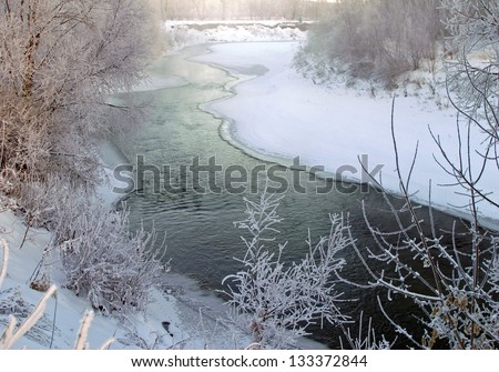 scenic winter landscape river and trees consecrated rising sun - stock photo