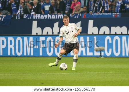 SCHALKE, GERMANY - SEP 21: Bastian Schweinsteiger (FC Bayern) during a Bundesliga match between FC Schalke 04 & FC Bayern Munich, final score 0-4, on September 21, 2013, in Schalke, Germany. - stock photo