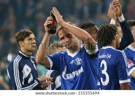 SCHALKE, GERMANY - SEP 21: Dante (FC Bayern) after a Bundesliga match between FC Schalke 04 & FC Bayern Munich, final score 0-4, on September 21, 2013, in Schalke, Germany. - stock photo