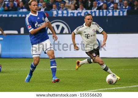SCHALKE, GERMANY - SEP 21: Franck Ribery (FC Bayern) vs. Benedikt Hoewedes (Schalke 04) during a match between FC Schalke 04 & FC Bayern Munich on September 21, 2013, in Schalke, Germany. - stock photo